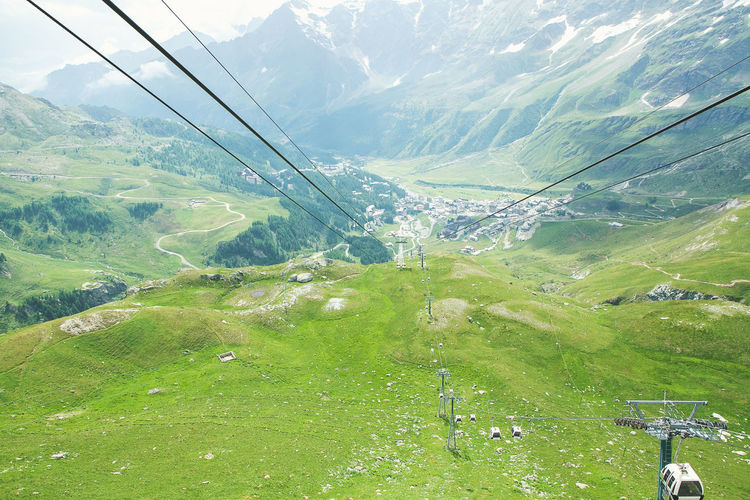 Scenic view of ski lift against sky