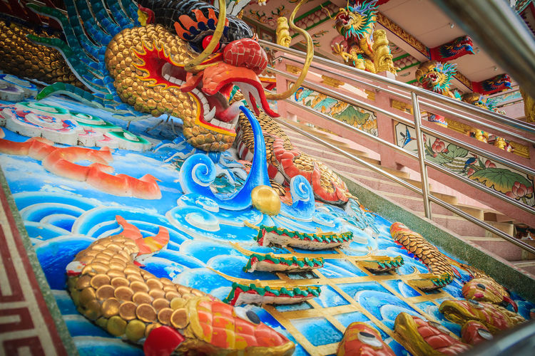 Colorful dragon sculpture at the entrance stair in Chinese temple Dragon Dragon Sculpture Animal Representation Architecture Art And Craft Belief Building Built Structure Chinese Dragon Craft Creativity Dragon Dragon Scales Dragon Statue Dragon Statues Dragon Stone Multi Colored No People Ornate Place Of Worship Religion Representation Sculpture Spirituality Statue