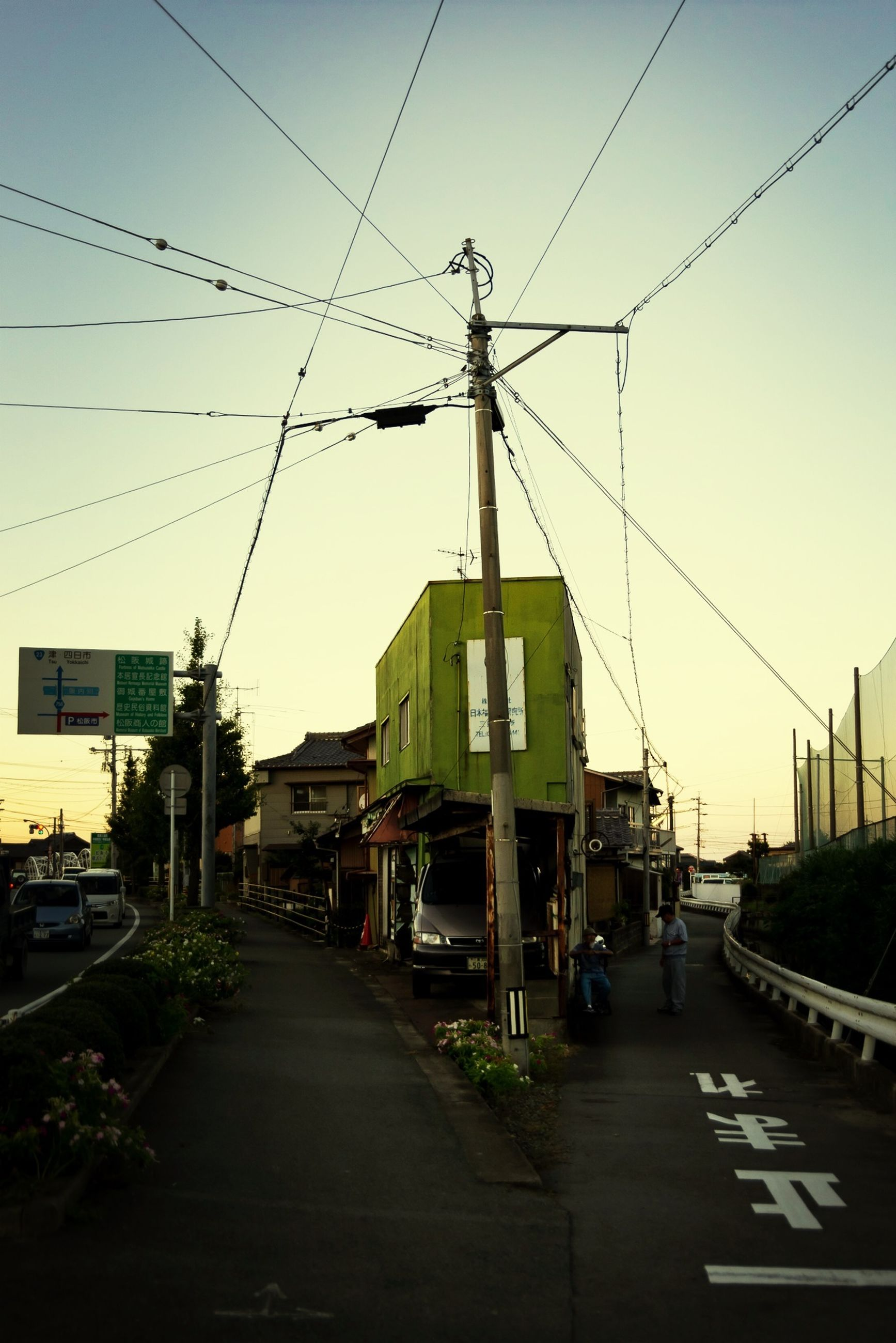 building exterior, architecture, built structure, power line, transportation, the way forward, electricity pylon, street, road, cable, clear sky, diminishing perspective, electricity, car, sky, city, power supply, vanishing point, mode of transport, outdoors