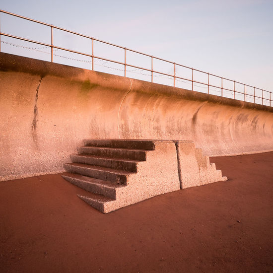 Steps Near Wall Partially Covered By Sand
