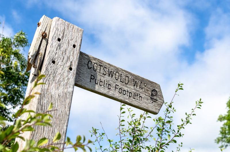 Cotswold Way. Plants Summertime Clouds Uk Cotswold Direction Signs Direction Sign Directional Sign Footpath Public Footpath Hike Trail Hiking Walking Route Walks Signpost Signange Public Footpath Sign Wooden Wooden Post Summer The Way Sign Post Directions Sky Nature No People Outdoors Day Sign