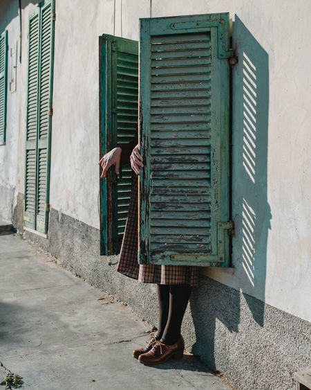 Low section of woman standing on building