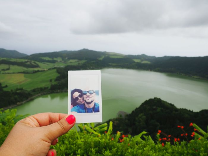 Human Hand Human Body Part Photograph Photography Themes Picture Frame Holding One Person Nature Landscape Outdoors People Day Adult Sky Adults Only 14-42mm Olympus Om-d E-m10 Olympus Lake Azores Furnas Vulcanic Mountain Nature Instax The Week On EyeEm Modern Love