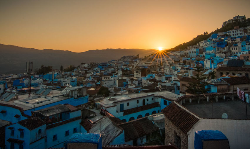 Blue sunset Architechture Blue Building Chefchaouen City Cityscape Colorful Colors Contrast Light And Shadow Morocco Orange Color Roof Sky Sun Sunset Town Travel