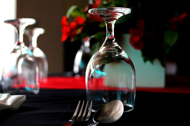 Close-up of upside down wineglass on table