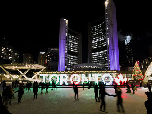 Toronto, Canada City Hall ice skating at night. Night view of ice rink with crowd at Nathan Philips Square NPS. Canada Photos Christmas Cityscape Nathan Philips Square Skating Rink Toronto Toronto Canada Toronto Christmas Market Toronto Ice Skating Toronto City Hall Toronto Cold Day Toronto Ice Rink Travel Architecture Canada City Cityscape Downtown District Ice Rink Illuminated Leisure Activity Night Skating TorontoLife Urban