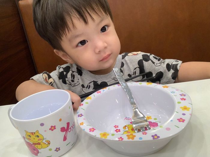 Childhood Child One Person Real People Indoors  Innocence Food And Drink Portrait Front View Cute Boys Lifestyles Casual Clothing Headshot Males  Food Leisure Activity Looking At Camera Table