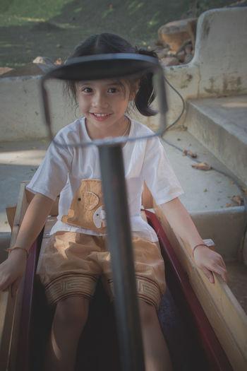Portrait of boy sitting on seat