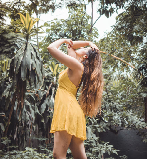 One Person Real People Leisure Activity Lifestyles Plant Tree Standing Women Casual Clothing Young Women Nature Hair Day Hairstyle Young Adult Adult Fashion Dress Growth Outdoors Human Arm Beautiful Woman