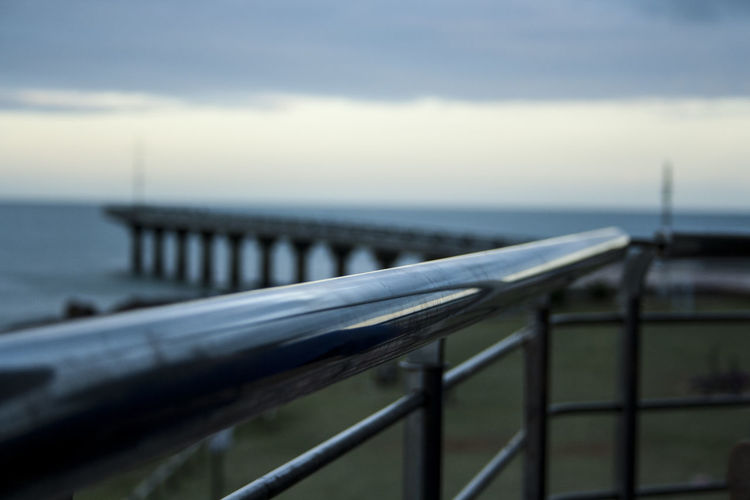 Abstract structures. Beauty In Nature Bridge - Man Made Structure Close-up Cloud - Sky Day Focus On Foreground Horizon Over Water Leading Lines Nature No People Ocean Outdoors Pier Railing Railing Scenics Sea Sky Steel Tranquility Water Exploring Style