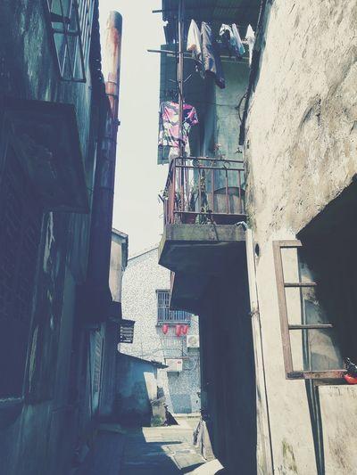 南浔Zhejiang,China The Week Of Eyeem Alleyway Clothes Building Windows Showcase July