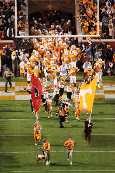 Smokies and Tennessee football teams entrance. The University of Tennessee entering Neland Stadium in Knoxville Tennessee in 2012 Big Orange Flags Football Knoxville Neyland Stadium Outdoors Smokie Team University Of Tennessee Volunteers The Color Of Sport