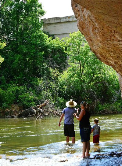 Wading to cool off Natural Bridge North Of Douglas Wyoming Afternoon Of Relaxation Throwing Rocks Sunny Afternoon Wonderful Day United States Thousands Of People Visit