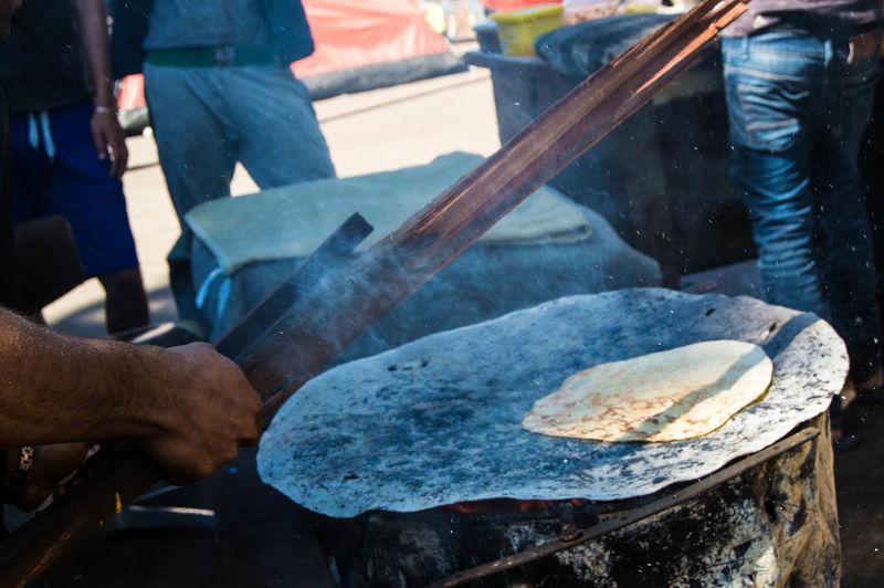 Man cooking food at refugee camp