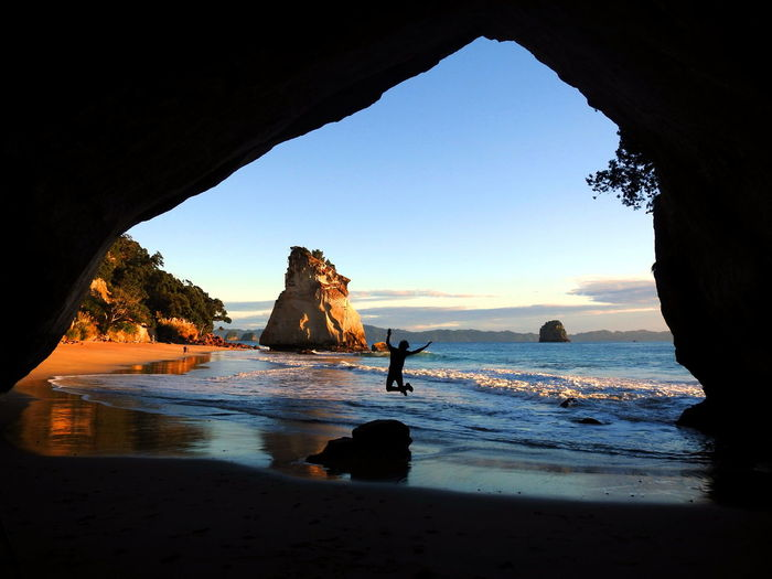 Morning Light Shadow And Light Shadowplay Silhouette Beach Beauty In Nature Cathedral Cove Cave Clear Sky Day Horizon Over Water Joy Jumping Natural Arch Nature Outdoors Physical Geography Rock - Object Rock Formation Scenics Sea Tranquil Scene Tranquility Water