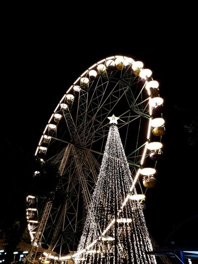 Life always goes up and down Ferris Wheel Night Amusement Park Outdoors No People
