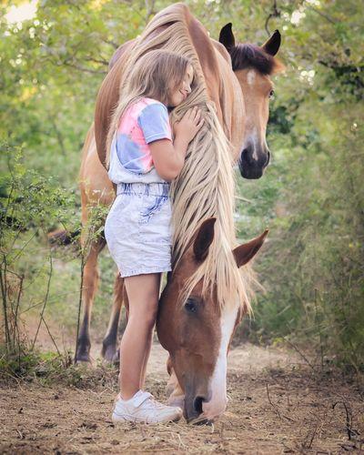 Full length of a girl standing in farm