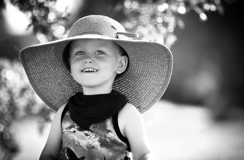 Happy girl wearing sun hat