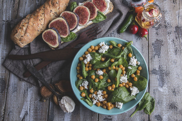 Chickpeas And Veggies Salad With Spinach Leaves, Homemade Cheese,healthy Vegan Food,sandwich With Figs, Diet Dish Chickpeas Food Healthy Eating Freshness Food And Drink Wellbeing Ready-to-eat Table High Angle View Bowl Vegetable Directly Above No People Fruit Still Life Indoors  Salad Eating Utensil Kitchen Utensil Serving Size Plate Garnish Vegetarian Food Glass Breakfast