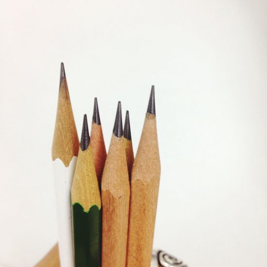 White Background Studio Shot Still Life Copy Space Pencil Colored Pencil Variation No People Multi Colored Close-up Yellow Variety Indoors  Pencil Shavings