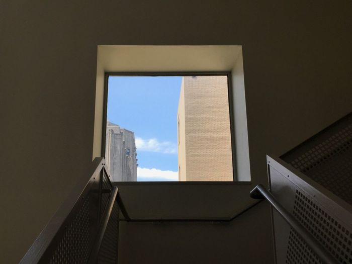 Low angle view of building from the bottom of a stairwell.
