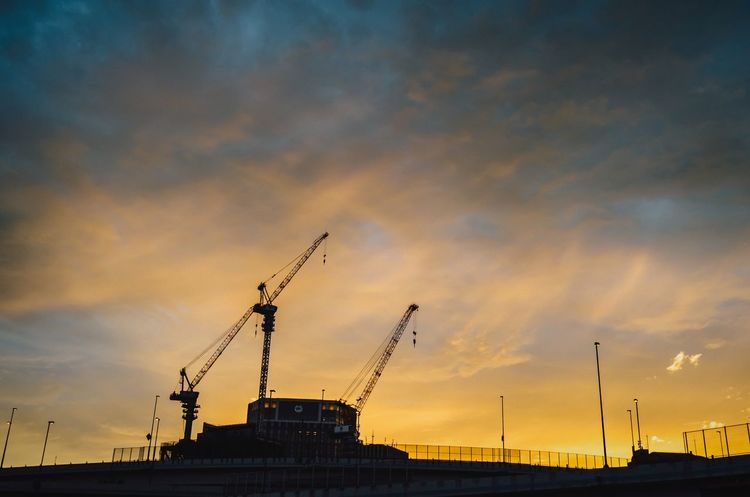 The Sunset Evening Sky Cloudscape Sunlight Reflection Going Home From Work Yokohama Station Crane - Construction Machinery Highway Bridge Built Structure Construction Site The End Of The Day Orange Sky Orange Sun No People Low Angle View Sunset Sky Evening View Shillouette Sunset And Clouds  Yokohama Yokohama, Japan September September 2017