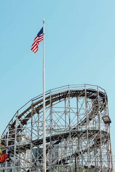 Coney Island, May 2012 American Flag Architecture Blue Blue Sky Clear Sky Coney Island Copy Space Culture Flag Flag Pole Fluttering High Section Identity Low Angle View Monument National Flag New York New York City Patriotism Pride Star Shape Tall - High Traveling USA Waving