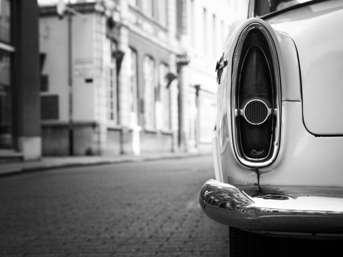 Close-up of old car on street