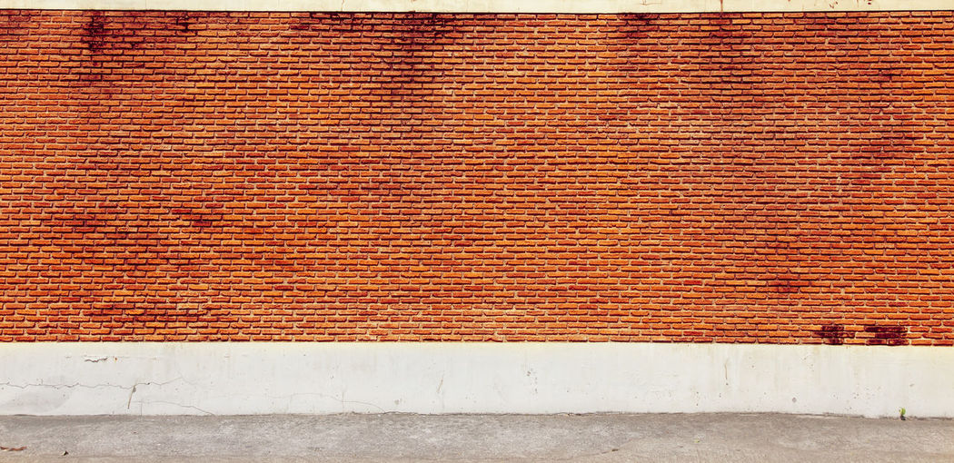 Vintage Industrial background, empty grunge street with warehouse brick wall. Pattern Wall - Building Feature Built Structure Backgrounds Textured  Architecture No People Wall Brick Wall Full Frame Brick Day Brown Red Building Exterior Close-up White Color Outdoors Flooring Design Concrete Red Vintage Rusty Texture Space Minimal
