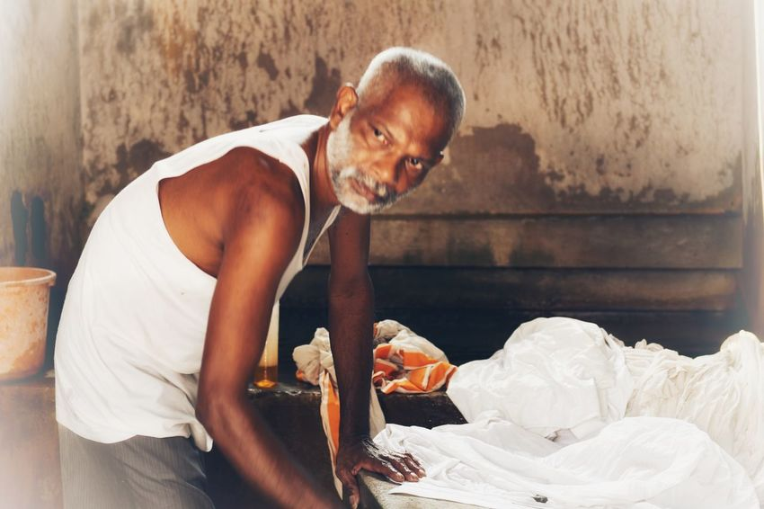 Dhobi waller in Cochin, India Dhobie Ghat Cochin, India India, Three Quarter Length One Person Making Preparation  Indoors  Real People Working Day Skill  Occupation Human Hand Adult