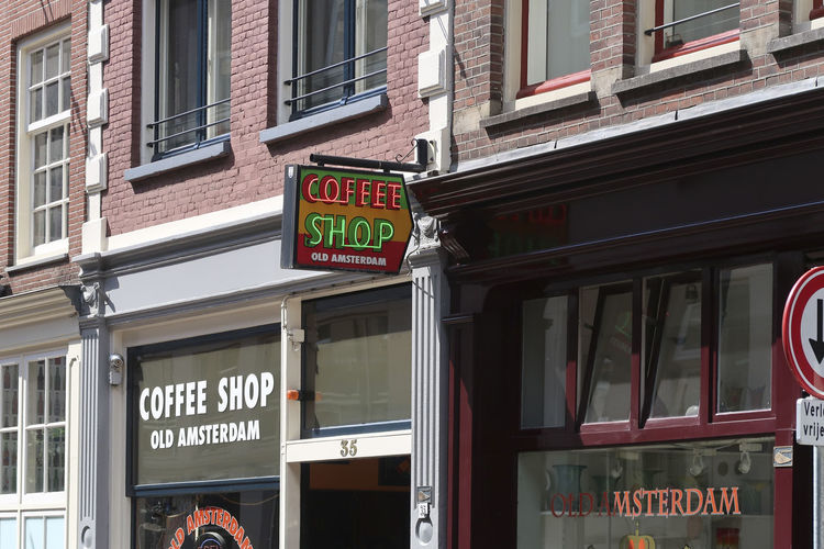 Amsterdam, the Netherlands - June 17, 2018: Coffee shop light marque logo above a coffee shop building in a shopping street in Amsterdam, showing there is soft drugs available for sale Coffee Shop Amsterdam Soft Drugs Sign City Building Exterior Commercial Sign Outdoors Building Street Shop