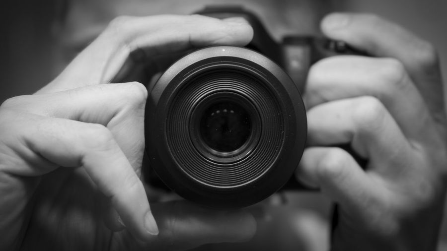 Close-Up Of Man Photographing By Using Camera