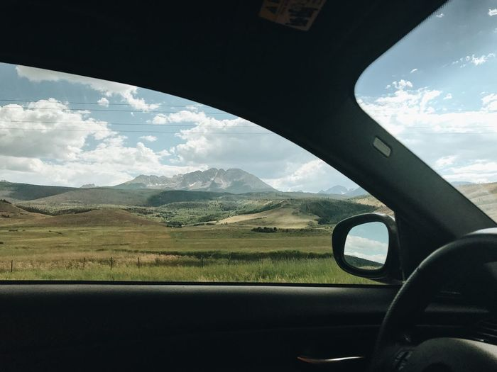 Scenic view of landscape seen through car windshield