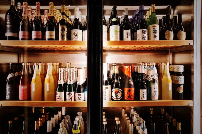 Shanghai Variation Food And Drink Refreshment Alcohol Drink Arrangement Indoors  In A Row Side By Side Large Group Of Objects No People Wine Bottle Order Abundance Bar - Drink Establishment Still Life Bottle Shelf Container Choice