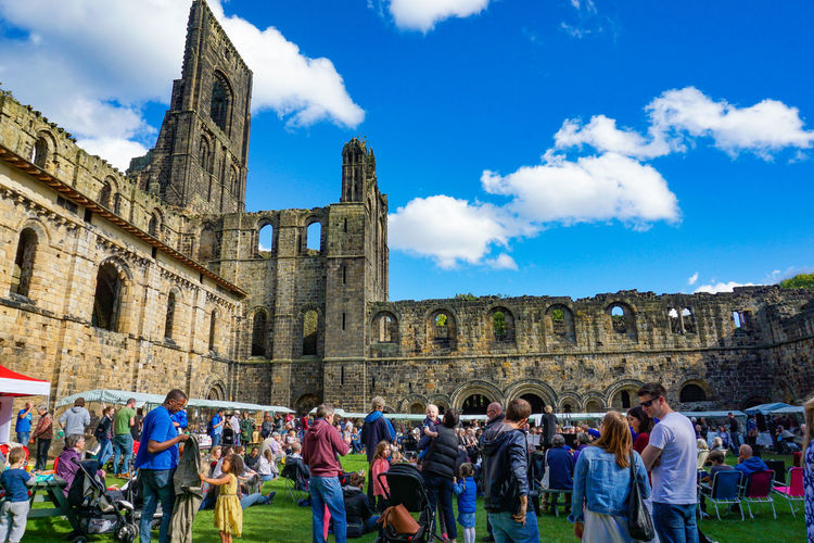 Leeds, England, United Kingdom - September 25, 2016: Kirkstall Abbey in Leeds with crowded people in green field Group Of People Architecture Real People Large Group Of People Built Structure Crowd Sky Men Women Building Exterior Cloud - Sky The Past Lifestyles Leisure Activity History Adult Tourism Day Travel Nature Outdoors Visit Ancient Civilization Festival England People Abbey Ruins Architecture Blue