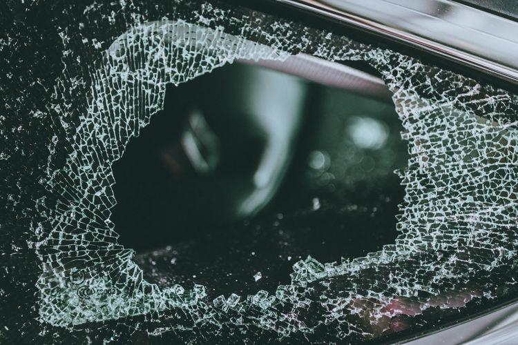 Close-up of broken car window