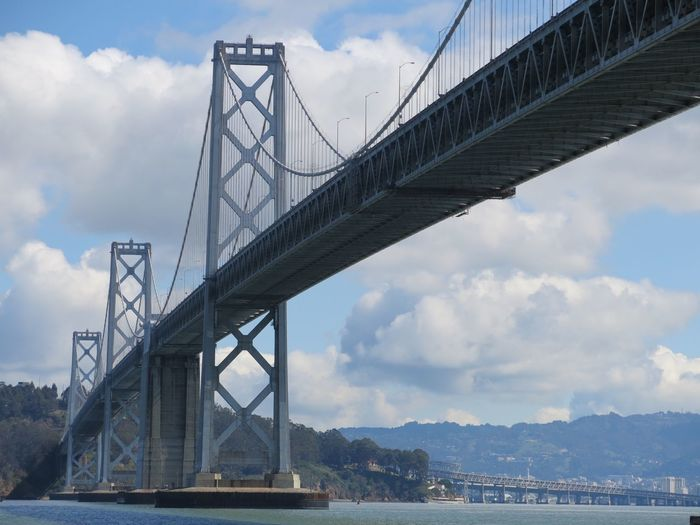Low angle view of san francisco-oakland bay bridge against sky