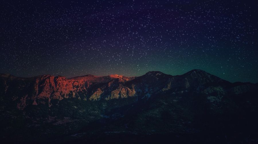 Idyllic view of mountains against star field