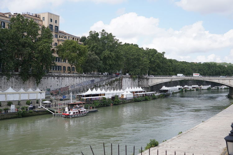 Tiber riverside in Rome, Italy, Italian Fiume Tevere, full of bars and restaurants on the embankment Isola Tiberina Isola Tiberina Rome River View Riverside Roma Rome Rome Italy🇮🇹 Rome, Italy Tevere River Tiber River Bridge - Man Made Structure Building Exterior City Nature No People River Riverbank Riverscape Rome Italy Tevere Tiber Tiber Island Tiber Island Rome Water Waterfront