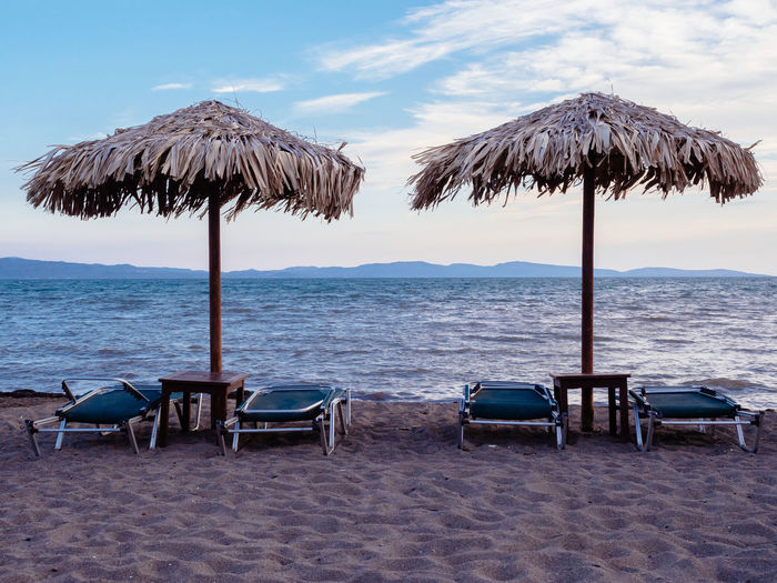 Outdoors Greece Lesvos Lesbos Island Greek Islands No People Water Vacations Holiday Umbrella Sea Beach Parasol Tranquil Scene Lounge Chair Horizon Over Water
