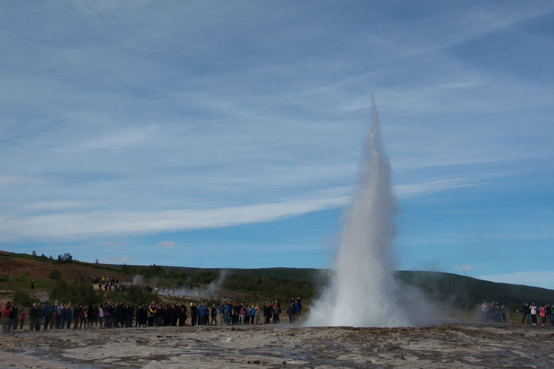 Strokkur & friends Strokkur Strokkur Geyser Travel Photography Traveling Black Sands Island Crowd Erupting Geothermal Activity Geyser Hot Spring Iceland Landmarks Large Group Of People Mass Tourism Motion Outdoors Power In Nature Travel Destinations Landscape A New Beginning