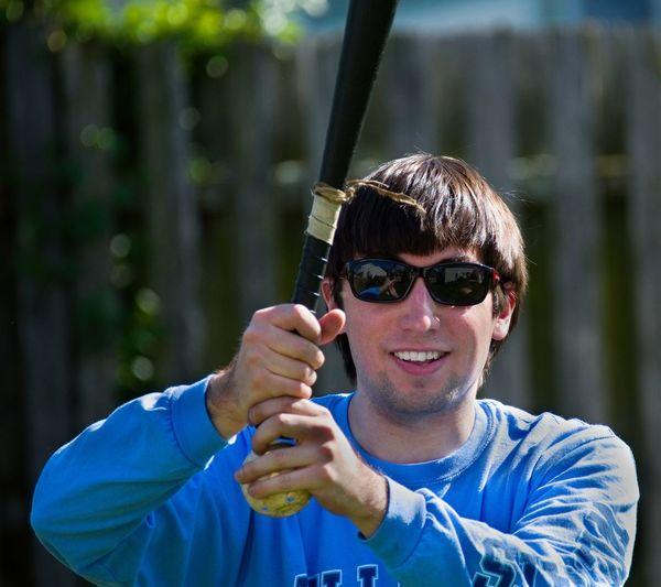 Portrait of smiling man holding baseball bat