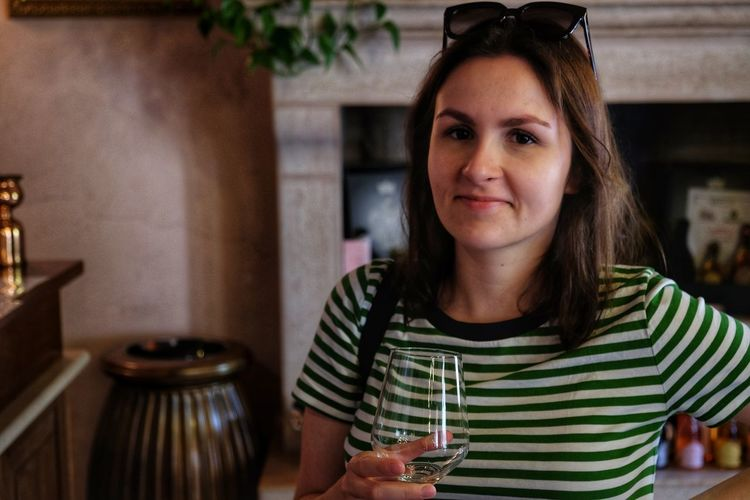 Martyna seems quite pleased with this tasting at local Sirmione winery called Cà dei Frati. We got whole crate of wine afterwards // One Person Real People Front View Looking At Camera Indoors  Young Adult Leisure Activity Young Women Lifestyles Food And Drink Smiling Portrait Headshot Cafe Happiness Beautiful Woman Day Close-upCasual Clothing Adult People FUJIFILM X-T10 XF18-55mmF2.8-4 R LM OIS F/3.6 ISO 800 via Fotofall