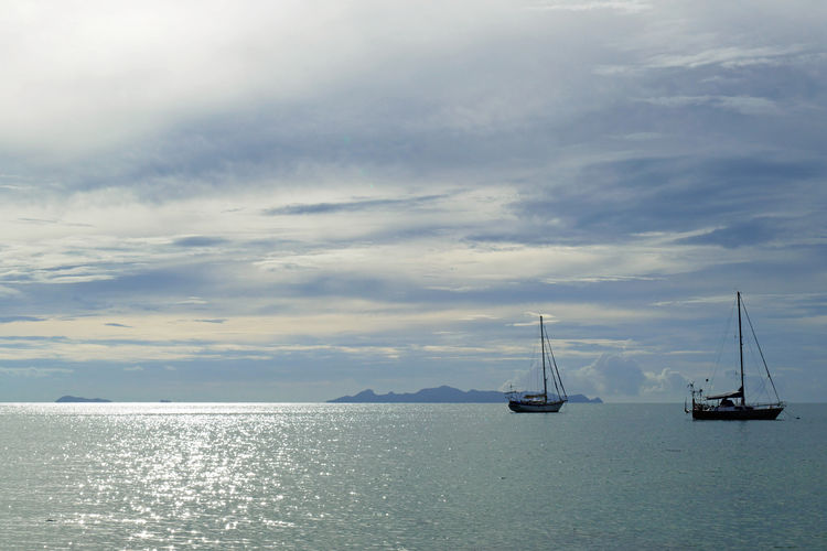 No People Tranquility Tranquil Scene Outdoors Nautical Vessel Sea Water Sailboat Cloud - Sky Sky Horizon Over Water Scenics - Nature Beauty In Nature Horizon Waterfront Pole Nature Yacht Sailing Moored Sailboats Moody Sky Seascape Sea And Sky