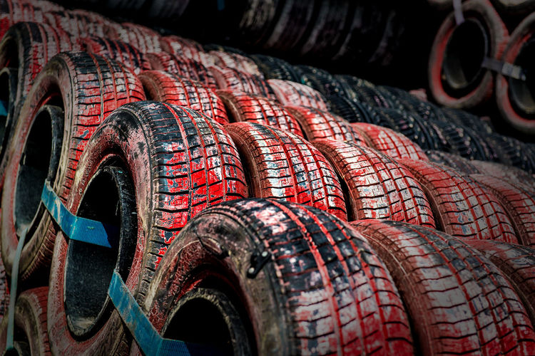 Row of tires. Protection around the track of the grand prix of Monaco Automobile Formula 1 Monaco Grand Prix Objects Red Tires Transportation Background Black Close-up F1 Formula Formula One Racing Full Frame Monte Carlo No People Nobody Protector Tire Tyre Tyres Wheels