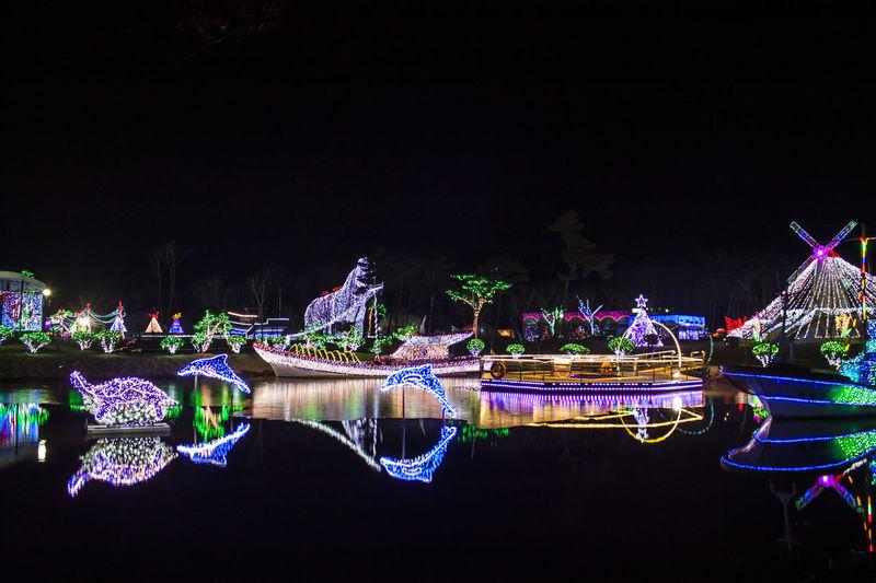 Night Illuminated Water Reflection Waterfront No People Architecture Glowing Built Structure Decoration Lake Amusement Park Tourism