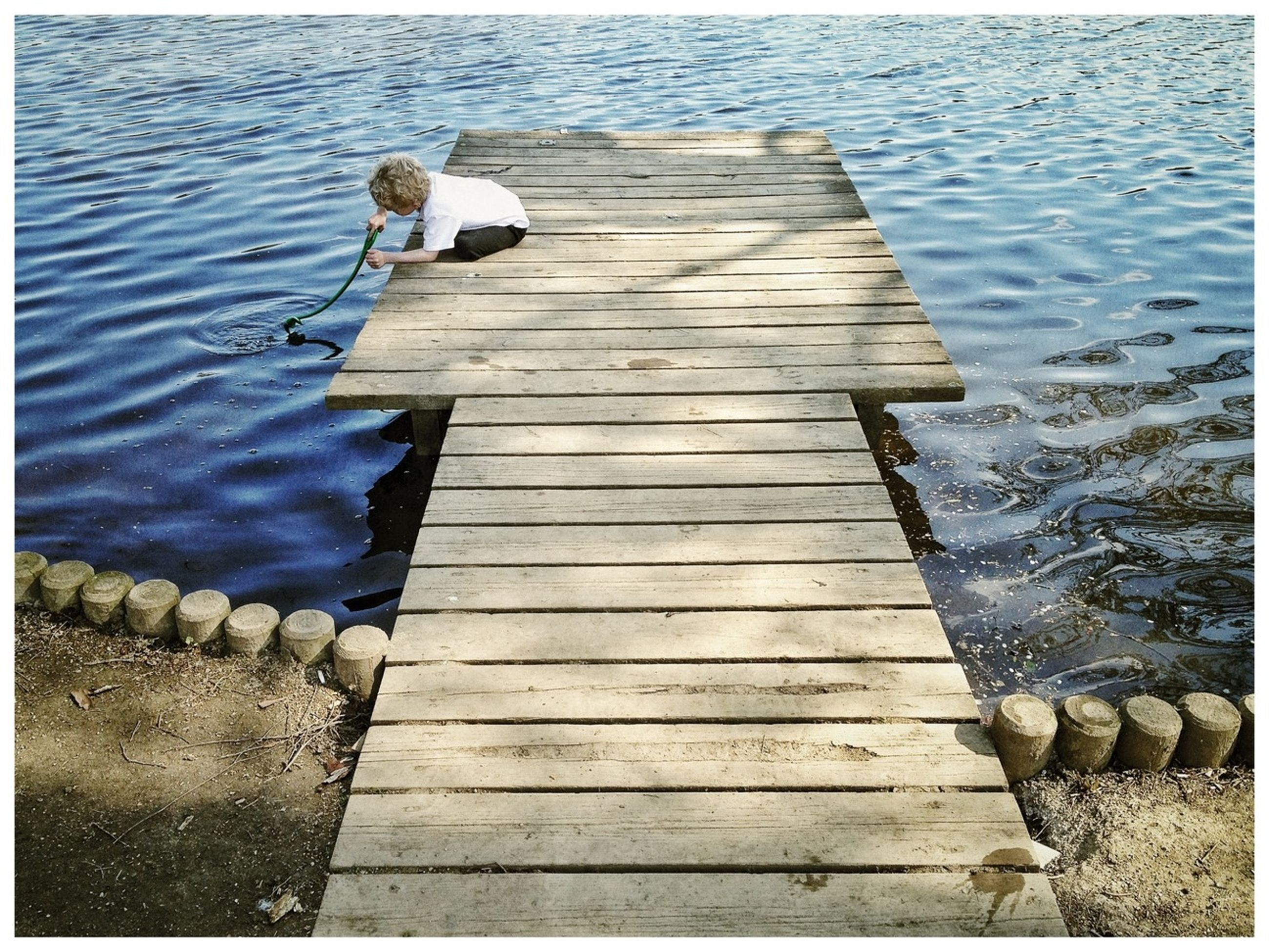 transfer print, water, wood - material, pier, auto post production filter, jetty, high angle view, wood, wooden, boardwalk, lake, plank, rippled, day, nature, tranquility, wood paneling, outdoors, the way forward, no people