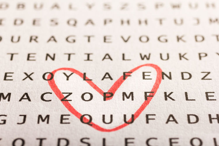 Puzzle, find the words Love Text Backgrounds Business Close-up Communication Creativity Document Emotion Heart Shape Letter Love Message Paper People Positive Emotion Puzzle  Selective Focus Sign Single Word Text Valentine's Day - Holiday Words