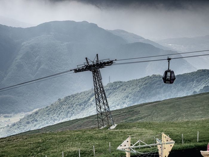 Mountain Cable Car Overhead Cable Car Cable Landscape Sky Environment Nature Technology No People Connection Electricity  Beauty In Nature Mountain Range Scenics - Nature Land Day Plant Transportation Outdoors
