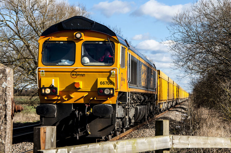 Composition Goods Train Land Vehicle Mode Of Transport On The Move Perspective Public Transport Rail Transportation Railroad Track Train Train - Vehicle Train Perspective Transportation Travel Vanishing Point Yellow Train